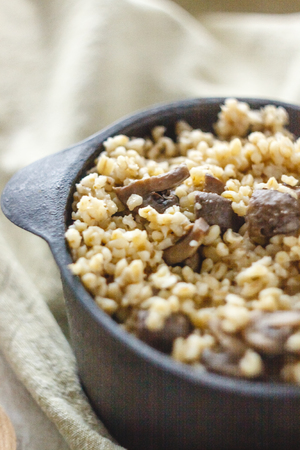 Cooked for the pot of bulgur porridge with mushrooms. The concept of proper healthy simple and wholesome food
