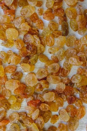 Background from light yellow raisins. Close-up