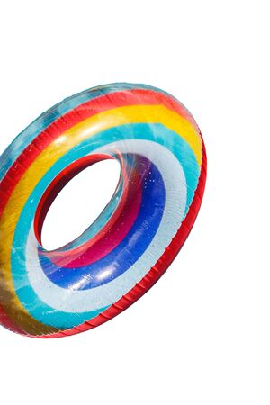 one inflatable rubber multi-colored life buoy isolated on a white background.