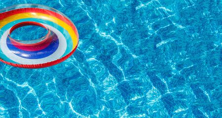 Inflatable water activities circles tuba float on the water in the pool. Concept, fun, perky summer and relaxation