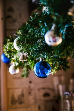 glass ball and decorations on Christmas tree ,Christmas tree garland with blue and silver balls, close-up. Perspective, blur.