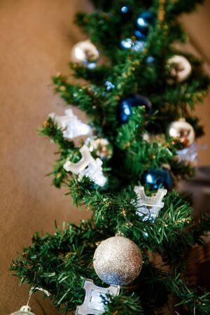 glass ball and decorations on Christmas tree,eiffel tower garland Zdjęcie Seryjne