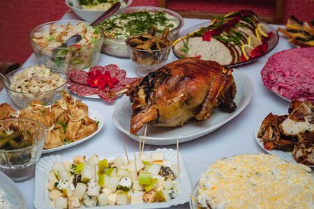 Festive home table, snacks, duck, stuffed pike fish