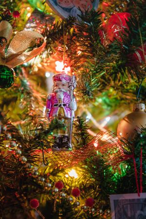Christmas tree nutcracker, Christmas toy, lifestyle, garland with lights.