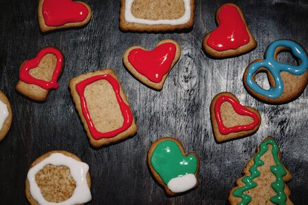 Christmas gingerbread with christmas decorations on dark stone background. Christmas baking background. Top view with copy space Zdjęcie Seryjne