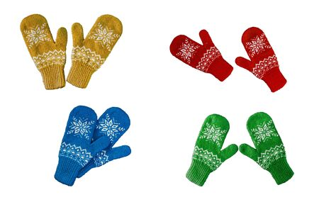 pair of red-blue-green-yellow knitted mittens with christmas pattern isolated on white background. Collage of different mittens.