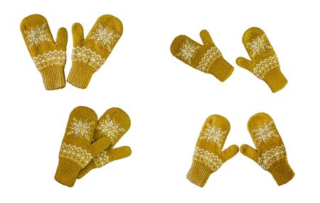pair of yellow orange knitted mittens with christmas pattern isolated on white background. Collage of different mittens. 版權商用圖片