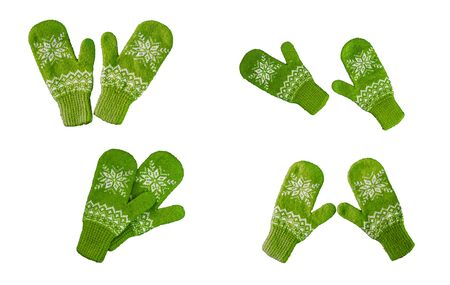 pair of green knitted mittens with christmas pattern isolated on white background. Collage of different mittens. 版權商用圖片