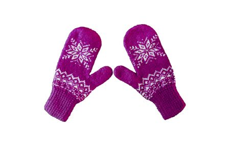 pair of blue and purple knitted mittens with christmas pattern isolated on white background. Collage of different mittens.