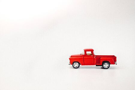 Red retro pickup car on a white isolated background with copy space