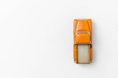 Yellow retro car pickup on a white isolated background. Top view with copy space. Flat lay.