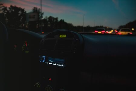 Torpedo in the car, tape recorder, the included radio in the evening dark light. Blur Selective focus