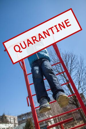 A photo of a child playing in a playground with a red QUARANTINE stamp. World pandemic coronavirus. Stop the coronavirus epidemic. Health and prevention of influenza and an infectious outbreak.