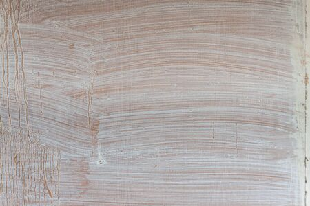 Wooden painted background with streaks of white paint