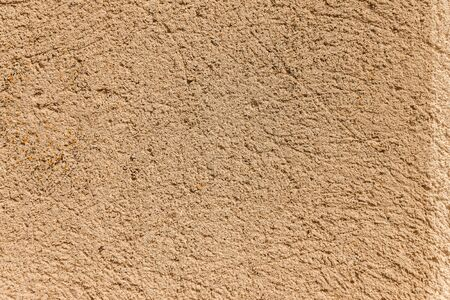 background of old cracked concrete, gray, pink. yellow sand