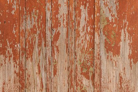 Wooden background from old boards, brick red orange Фото со стока