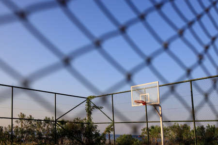 view through the net to the basketball court on a clear sunny day in the resort of Alanya, Turkey