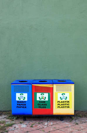 three different garbage cans for recycling garbage on a street in Turkey. Separate buckets for plastic, paper, glass,. Eco-friendly lifestyle to protect the environment. 免版税图像