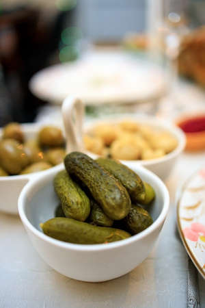 Russian appetizer of pickled gherkins on a festive Christmas table 免版税图像