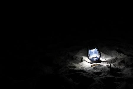 Lamp in the night beach Stock Photo