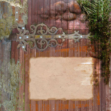wooden background with ancient hinge and ivy photo