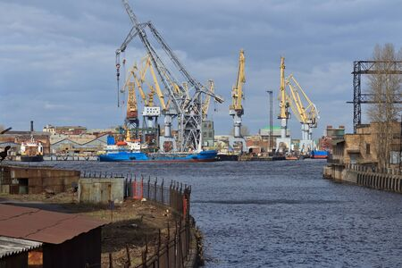 industrially: industrial landscape with shipyard, boats and cranes