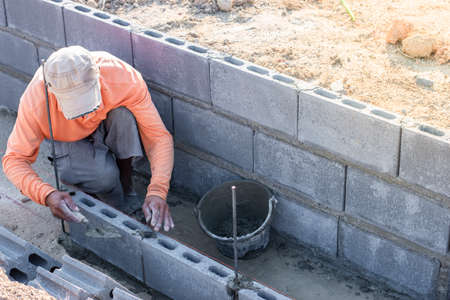 Workers are laying blocks of bricks, Construction work
