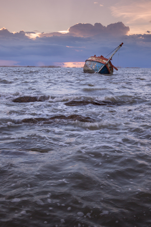 brighton: old fishing boat in the sea Stock Photo