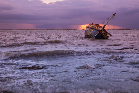 old fishing boat in the sea Stock Photo