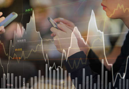 Business person or stock trader are using smartphone for stock trading by graph indicator and price data analysis, stock technical chart analysis concept