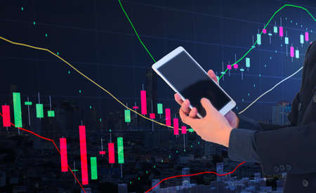 business man or stock trader holding tablet with stock graph chart, stock market analysis concept