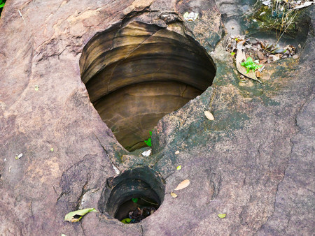 Amazing stone hole the hole is like a pot, is a natural hole.The hole is the largest group in Thailand. There are no less than 16 holes with many sizes ranging from 40 -300 cm wide mouth - 10 m. deep 写真素材