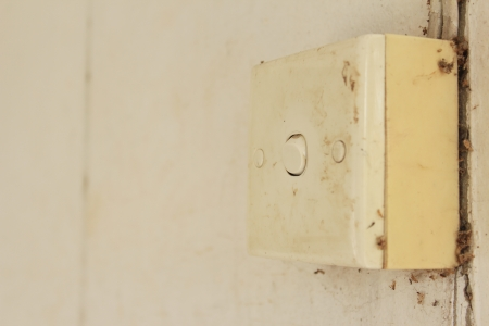 cast off: old and dirty switch in house  Stock Photo