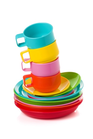 Stack of plastic corlorful cups and plates - perfect for picnic isolated on white