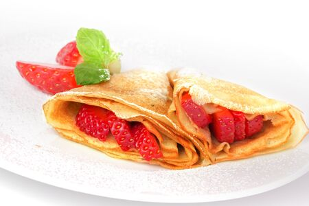 pancakes. crepes with with strawberry on white background photo