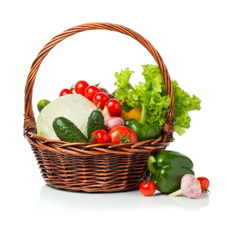 fresh vegetables with green salad  in a basket isolated on white Stock Photo - 19291296