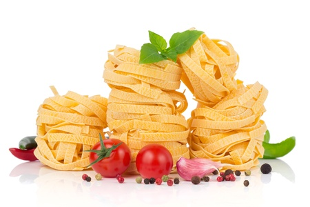 Italian food  - pasta, tomatoes, basil, garlic and pepper photo