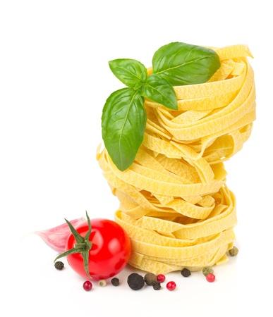 Italian food  - pasta, tomatoes, basil, garlic and pepper Stock Photo