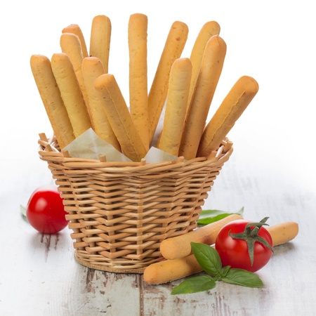Grissini - fresh breadsticks in a basket on wooden table