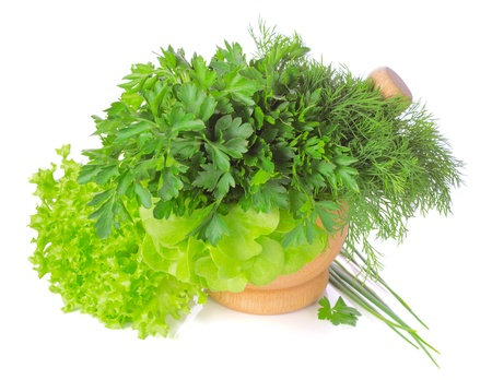Green herbs in a pounder isolated on white background Stock Photo