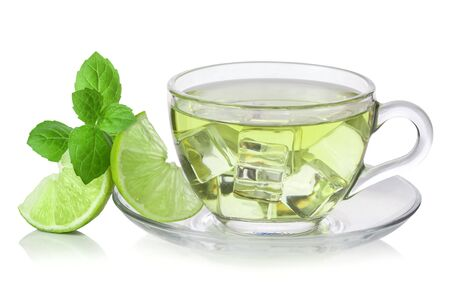 Cold green tea with ice cubes, lime sliced and mint leaves photo