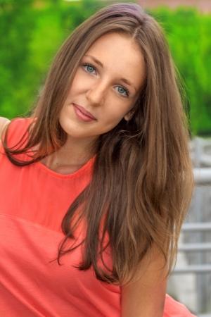 Beautiful teenage girl outdoors photo
