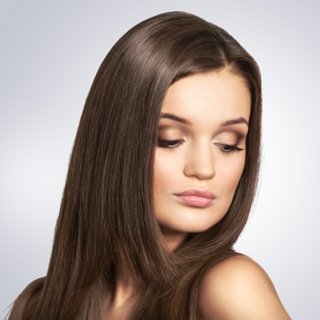 look make: Portrait of beautiful  woman with long brown hair on white background. Evening look make up  Stock Photo