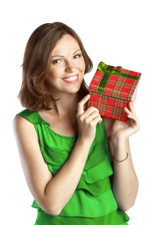 Young smiling woman in green dress with a gift box photo