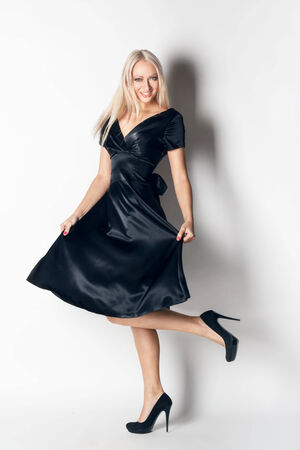 flyaway: beautiful woman in elegant silk dress in  fashion pose. studio shot.