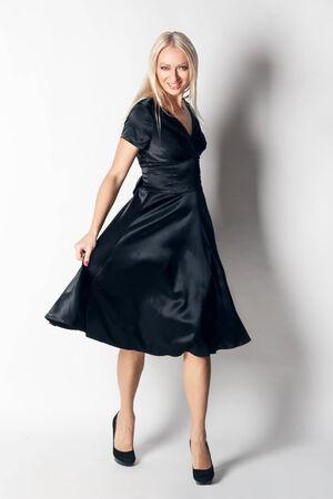 flyaway: beautiful woman in elegant silk dress in  fashion pose. studio shoot.