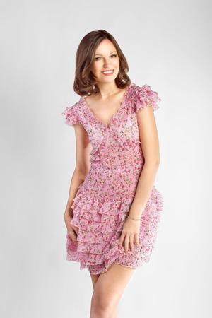 Full-length portrait of a lovely brunette woman in romantic dress Stock Photo