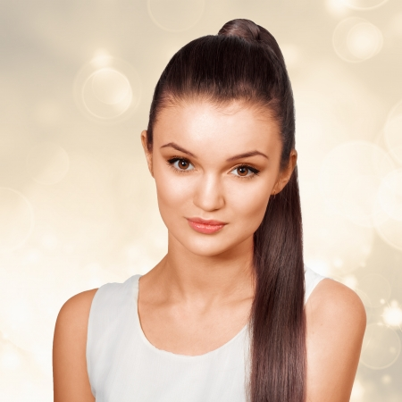 pony tail: Young female with healthy shining brown hairs put in pony tail.  Stock Photo