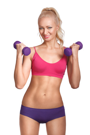 Young beautiful woman in fitness wear with dumbbells  Stock Photo