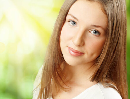 Cute young woman outdoors. Close-up portrait. photo